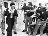 Atlanta Child Murders suspect Wayne Williams avoids questions from newscrews as he is escorted by...