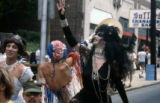 Participants in the Atlanta Pride parade celebrating through downtown, 1977