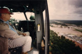 Governor Zell Miller flies over Macon to assess the flood damage below, 1994