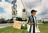"Macon resident selling ""I survived the flood"" t-shirts on the side of the road, 1994"