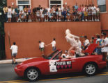 Participants in the annual Pride Parade waving to crowds watching along the parade route, 1993