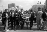 Coretta Scott King walking with a wreath of victims names in the Save the Youth Walk-A-Thon for...