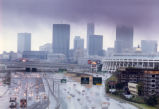 Skyline view of rain falling on Atlanta, Georgia, October 10, 1990. View over highway, with...