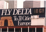 Delta Airlines billboard being repainted in downtown Atlanta, Georgia, June 9, 1993. Sign reads,...