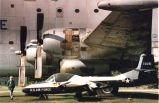 Joseph Mayer stands next to aircraft in the Robins Air Force Base Museum of Aviation, near Warner...