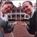 Two women in costume outside Stately Oaks Plantation house, Jonesboro, Georgia, January 14, 1993.
