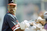Atlanta Braves infielder Fred McGriff signing autographs during spring training, Orlando, Florida,...
