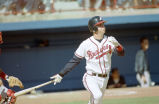 Atlanta Braves Chipper Jones hits a home run during spring training, Orlando, Florida, March 4,...