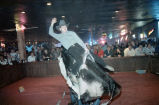 Patron, Craig Bunton, riding a mechanical bull at Mama's Country Showcase, Belvedere Park,...