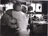 Tom Fox's parents, Bob and Doris, hug in his hospital room at Sacred Heart Hospital, Eugene,...