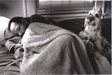 Tom Fox hooked up to his portable oxygen tank, shivering and unable to get out of bed -- with his...