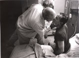 Bob and Doris, Tom Fox's parents, visiting him at Crawford Long Hospital, shortly after he was...
