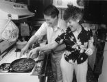Playwright Cary Bynum and actor Brenda Bynum prepare dinner at home, Atlanta, Georgia, June 1985.
