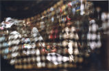Middle East or South Asia market place viewed from inside the net of a burqa, photograph by Jean...
