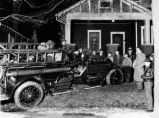 Reversed photo, night scene, winter, fire truck on front lawn of an Atlanta bungalow, ca. 1940.