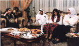 Muslim people during a meal, Middle East (?), photograph by Jean Shifrin, 1992.