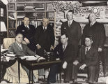 Franklin D. Roosevelt (seated, left) and politicians, including Herman Talmadge (seated, far...