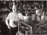 Grocer Doc Hillman in his store; one of many landowners who signed a lease with a kaolin company,...