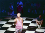 "James Leys III (center), as C.K. in Rebecca Ranson's ""Higher Ground: Voices of AIDS,""..."