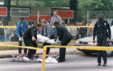 Body of slain Atlanta police Officer Randy J. Schipani being removed from the scene of the crime,...