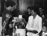 Atlanta Police Chief Dr. George Napper, Jr., awarding a metal to the widow and child of slain...