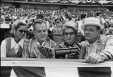 Atlanta Braves fans Mr. and Mrs. Arthur Montgomery (left) and Mr. and Mrs. Mills B. Lane, at the...