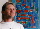 Jeff Higdon, 32, artist with one of his paintings. Lions Lighthouse Foundation paid for laser...