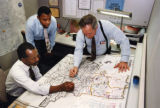 City planners looking over a map of Atlanta neighborhoods, Atlanta, Georgia, December 11, 1991.