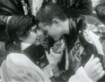 Margie Edouard (left, in wheelchair) comforts Heidi Deming, at an AIDS march to the Center for...