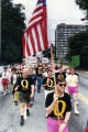 Richard Braddock, carrying U.S. flag, leads group of Queer Nation Atlanta, in the annual Gay Pride...