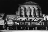 Anti-death penalty protesters stage a night vigil outside the State Capital, Atlanta, Georgia,...