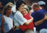 Barbara Morton (left) and Lorraine Fontana hug each other after exchanging vows Saturday in...