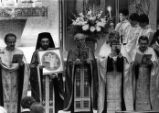 Reverend Father Homer P. Goumenis (far left)leads service at the Greek Orthodox Cathedral of the...
