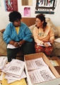 Terra Williams of Seattle (left) and Mariposa of Santa Cruz, Calif., bind programs for the first...