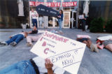 ACT-UP die-in in front of Grady Hospital, protesting the six-month waiting list of AIDS patients...