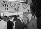 Dan Sweat (right), speaking with an unidentified man at an Atlanta Chamber of Commerce event...
