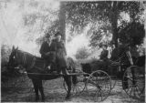 Four members of the Miles, Mlloy, Altman and Overstreet families, with horse and buggy, Alma,...