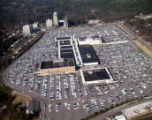 Aerial view of Lenox Square and its surrounding parking lot; Lenox Square Theatre in the...