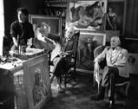 Artists (left to right) Marc, Constantin, and Roman Chatov, shown with their paintings, Atlanta,...