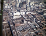 Aerial view of the city, looking north, showing the many parking lots and decks; the State of...