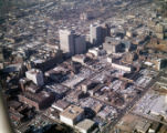 Aerial view of downtown, looking northwest, showing large areas covered in parking lots around the...