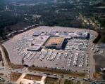 Aerial view of the Cobb County Shopping Center and its surrounding parking lot, with a view...