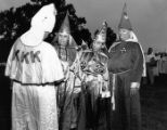 Imperial wizard, Sam Roper, being helped into his robe at a Ku Klux Klan rally, Georgia, August...