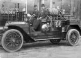 Fire engine and the two members of the Fire Department, East Point, Georgia, 1911.