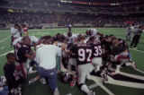 Atlanta Falcons team kneeling in prayer following a game in the Super Bowl playoffs, Georgia Dome,...