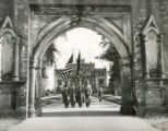 "Students march holding flags through ""Old Capitol Gates"" of college. Georgia Military..."