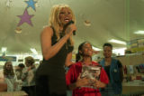 RuPaul with young fan, Seanna Turner, at a book-signing event for RuPaul's autobiography,...