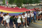 Participants in the 25th annual Gay Pride Parade marching north on Peachtree Street with a large...