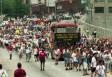 Double-decker bus, representing the Armory bar, and other participants of the 25th annual Gay...