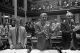 Congressmen applauding during the Georgia State House of Representatives' vote on the ratification...